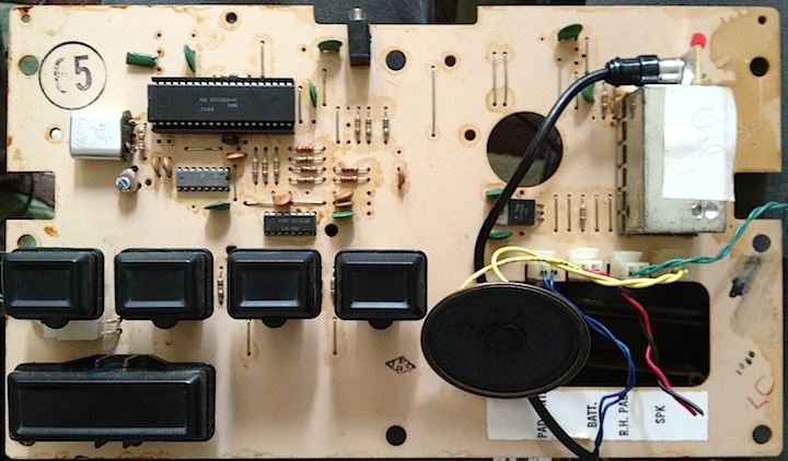 The interior PCB. The internal speaker is floating lower right.